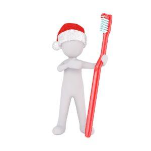歯ブラシを持っている小さな3D人形